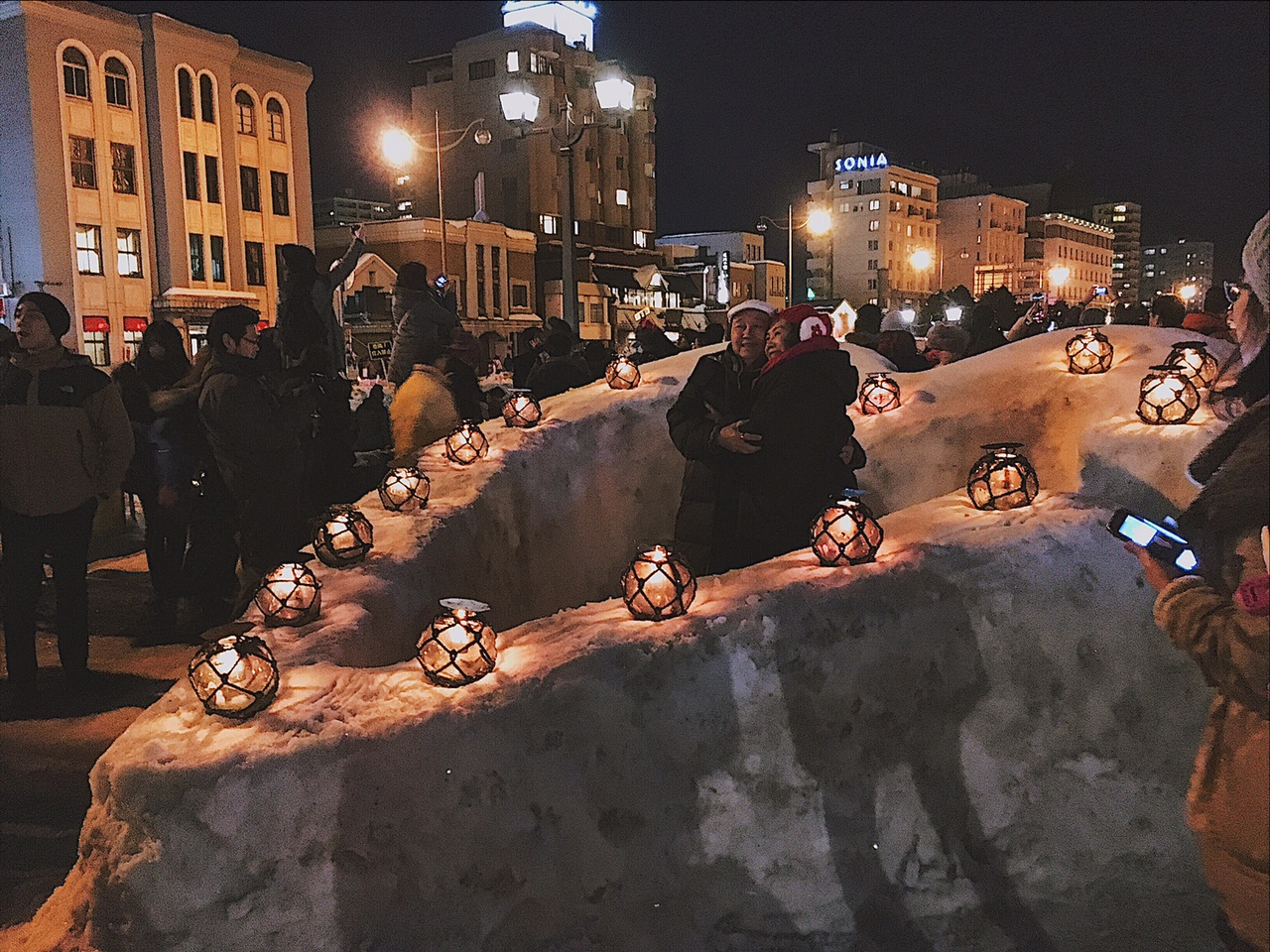 Old couple in love at Otaru Snow Light Path Festival