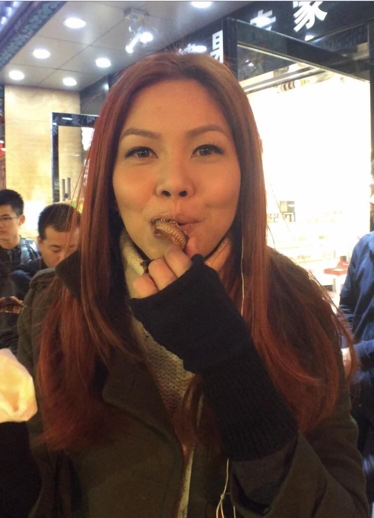Bianca Valerio eating snake Wangfujing Snack Street
