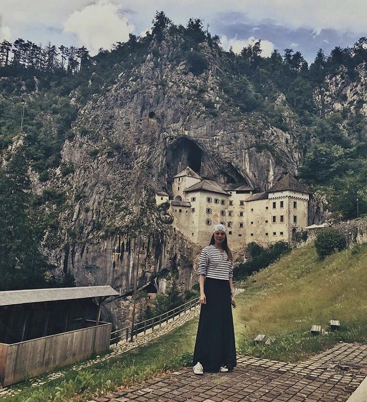 Slovenia Bianca Valerio Predjama Castle